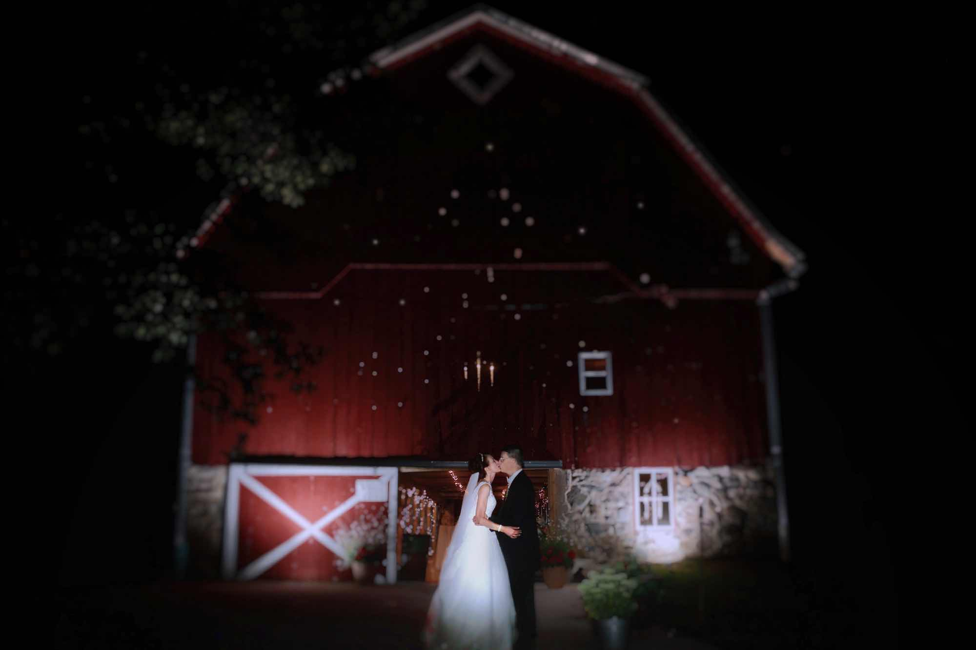 Married Couple in front of barn