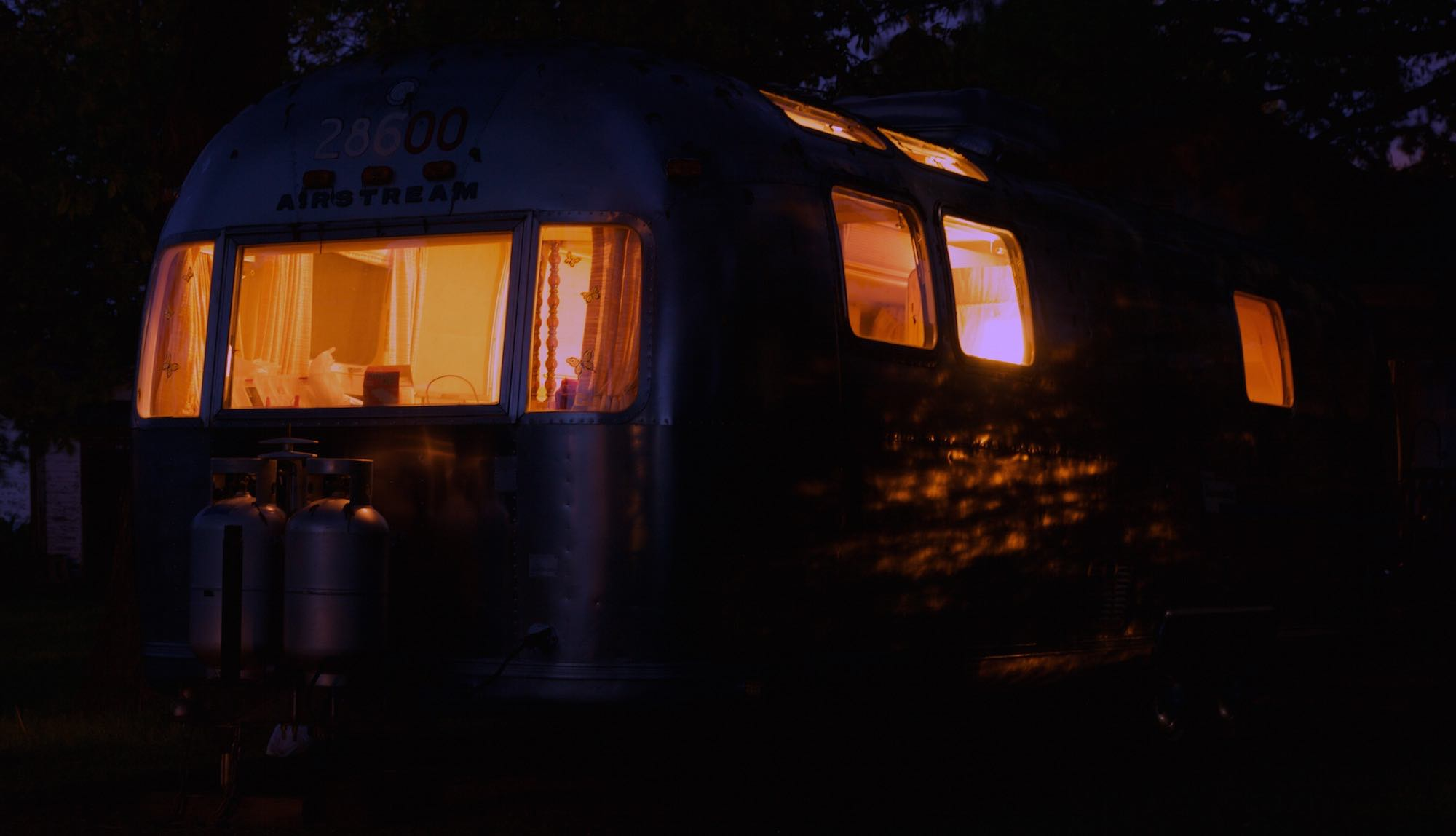 A night view of our Airstream camper.