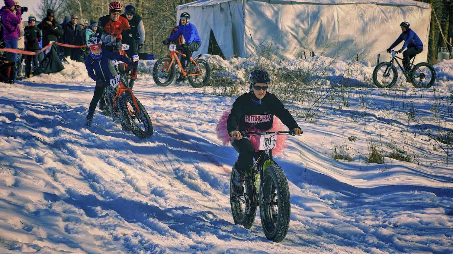 Fat bikes and fashion come together for a young racer sporting a tutu.