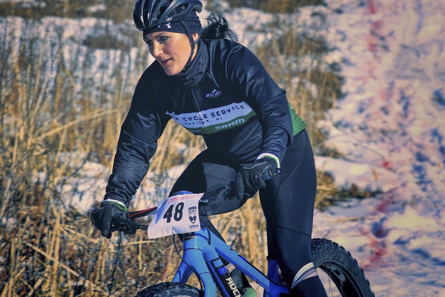 A racer concentrates on accelerating out of a corner on her Fat Bike during the Fat Cupid for 2017.