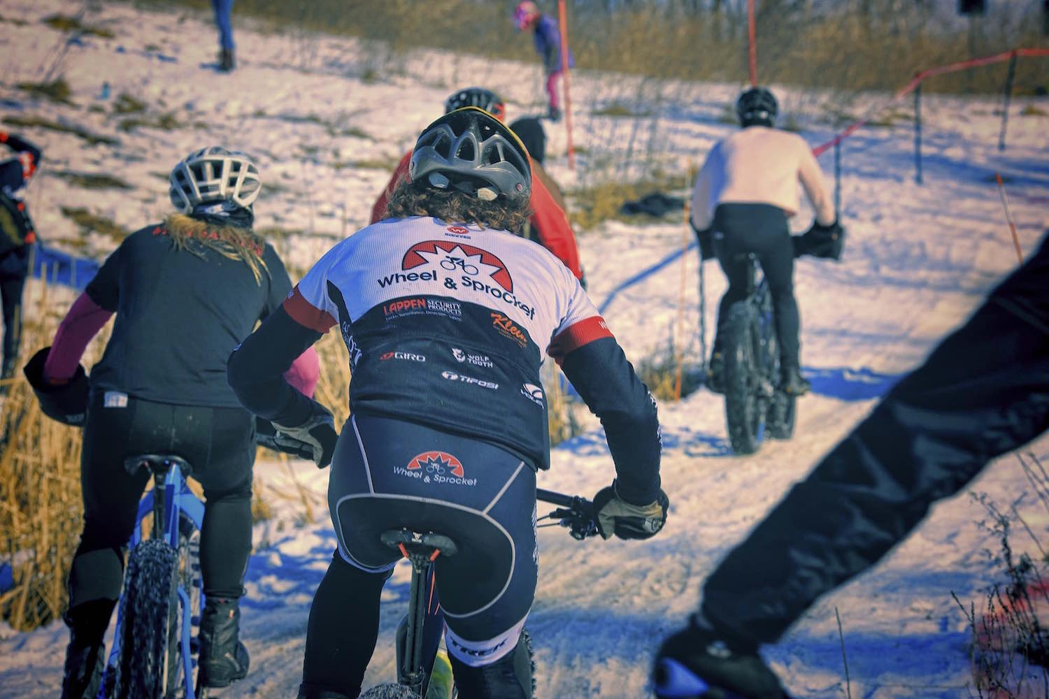 The fat bike peloton thunders down a straightaway at Lecker Park in Appleton, Wisconsin.