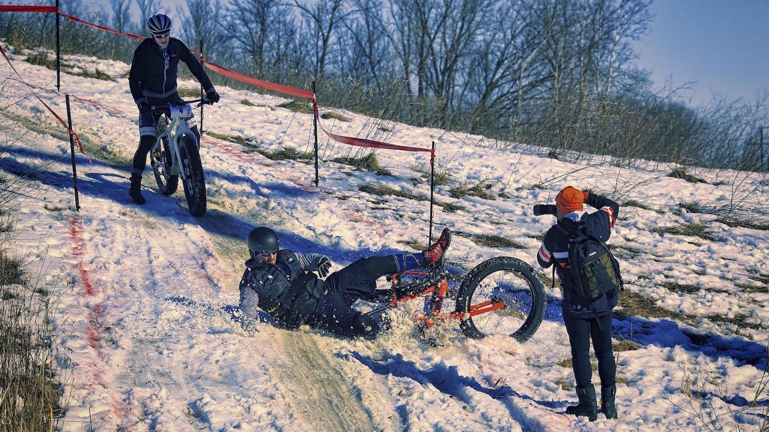 A fat bike crash on the slippery descent of the Fat Cupid Classic.