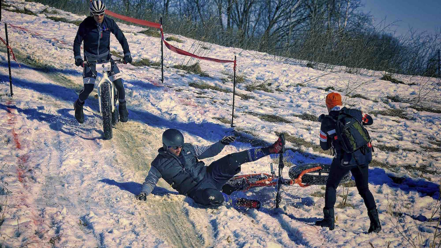 A rider crashes his fat bike during the Fat Cupid Classic.